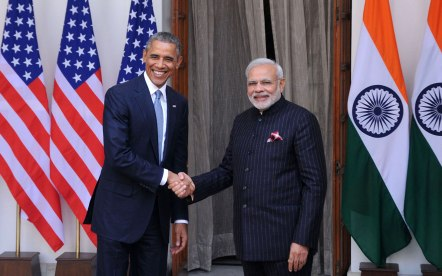 Indian Prime Minister Narendra Modi (R) shakes hands with US President Barack Obama prior to a meeting in New Delhi on January 25, 2015. US President Barack Obama held talks January 25 with Prime Minister Narendra Modi at the start of a three-day India visit aimed at consolidating increasingly close ties between the world's two largest democracies. (Photo by Vinod Singh/Anadolu Agency/Getty Images)